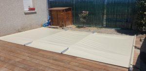 Couverture de sécurité à barres sur piscine coque polyester -10m²